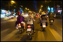 Motorbike riders at night from riders perspective. Ho Chi Minh City, Vietnam (color)