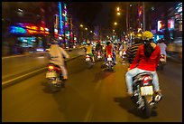 Riders view of motorcycle traffic at night. Ho Chi Minh City, Vietnam (color)
