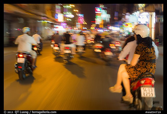Riders view of motorcycle traffic blurred by speed. Ho Chi Minh City, Vietnam (color)