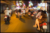 Riders view of motorcycle traffic blurred by speed. Ho Chi Minh City, Vietnam ( color)