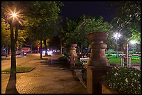 Sidewalk and park at night. Ho Chi Minh City, Vietnam (color)