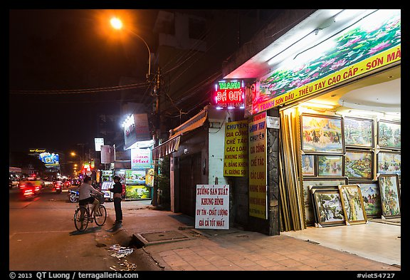 Stores selling pictures at night. Ho Chi Minh City, Vietnam (color)