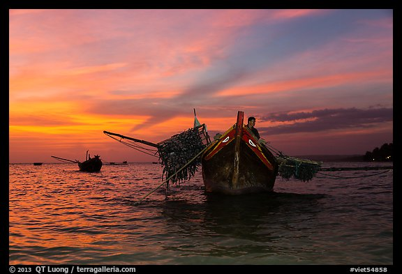 Man on fishing boat at sunset. Mui Ne, Vietnam (color)