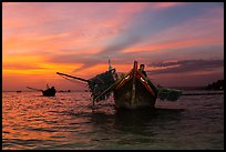 Man on fishing boat at sunset. Mui Ne, Vietnam ( color)