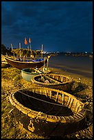 Coracle boats at night. Mui Ne, Vietnam (color)