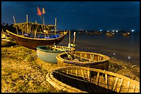 Coracle boats and fishing fleet at night. Mui Ne, Vietnam ( color)
