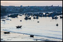Fishing fleet and village at dawn. Mui Ne, Vietnam (color)