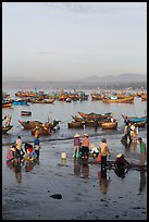 Miror-like beach and fishing boats, early morning. Mui Ne, Vietnam ( color)