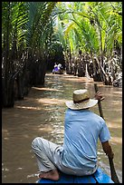 Padding in mangrove-lined narrow waterway, Phoenix Island. My Tho, Vietnam (color)
