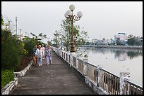 Elderly women strolling on riverfront. Tra Vinh, Vietnam (color)