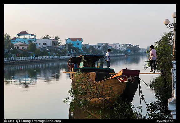 Couple on barge, Long Binh River. Tra Vinh, Vietnam (color)