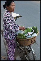 Woman vending food out of bicycle. Tra Vinh, Vietnam (color)