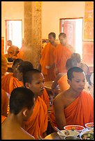 Theravada monks in dining room, Hang Pagoda. Tra Vinh, Vietnam ( color)