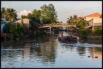 Barge and canal-side houses. Mekong Delta, Vietnam (color)
