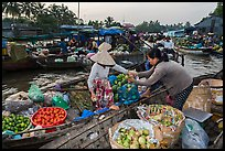 Fruit being sold from boat to boat, Phung Diem floating market. Can Tho, Vietnam ( color)