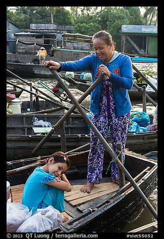 Woman and girl, Phung Diem floating market. Can Tho, Vietnam (color)