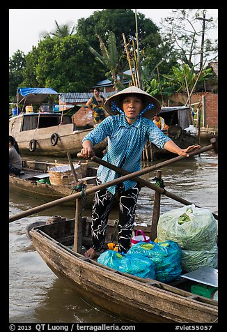 Woman using the x-shape paddles. Can Tho, Vietnam (color)
