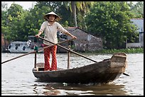 Woman using the distinctive x-shape paddle. Can Tho, Vietnam ( color)