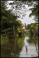 Woman walking across monkey bridge. Can Tho, Vietnam ( color)