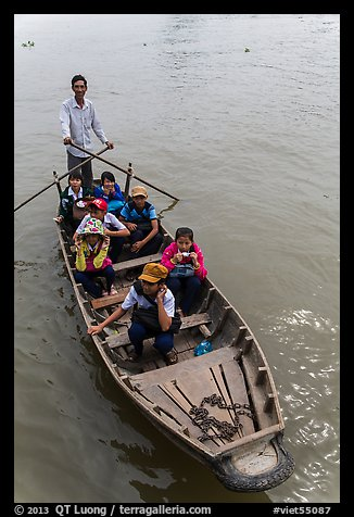 Schoolchildren rowed by parent. Can Tho, Vietnam (color)
