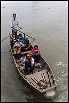 Schoolchildren rowed by parent. Can Tho, Vietnam ( color)