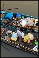 Couples on two side-by-side boats seen from above. Can Tho, Vietnam ( color)