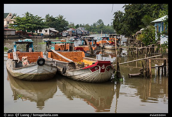 Boats loaded with bricks. Can Tho, Vietnam (color)