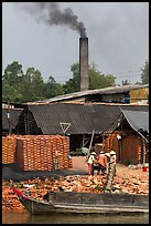 Workers moving bricks in brick factory. Sa Dec, Vietnam (color)