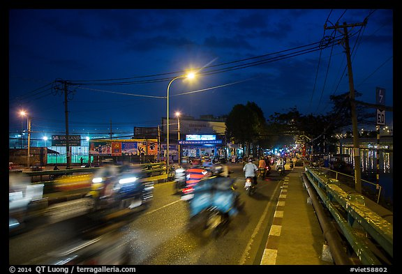 Evening traffic by the canal, District 8. Ho Chi Minh City, Vietnam (color)