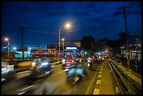 Evening traffic by the canal, District 8. Ho Chi Minh City, Vietnam ( color)