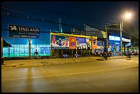 Street and stadium at night, District 8. Ho Chi Minh City, Vietnam ( color)