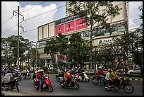 Motorcycle traffic and Hung Vuong Plaza mall. Cholon, Ho Chi Minh City, Vietnam ( color)