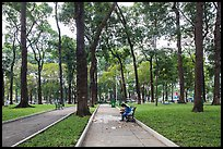 Couple looking at mobile phone, April 30 Park. Ho Chi Minh City, Vietnam ( color)