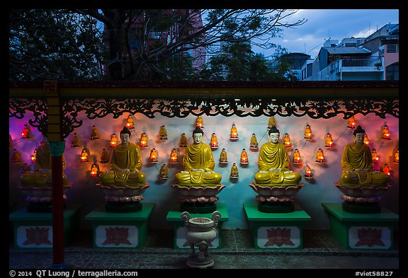 Buddha images at dusk, Viet Nam Quoc Tu pagoda. Ho Chi Minh City, Vietnam (color)
