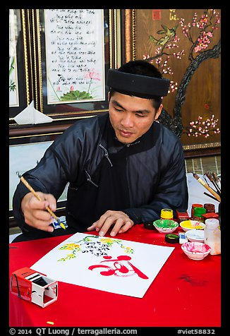 Caligrapher in traditional costume. Ho Chi Minh City, Vietnam (color)