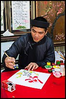 Caligrapher in traditional costume. Ho Chi Minh City, Vietnam ( color)