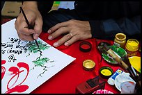 Hands drawing Tet greetings. Ho Chi Minh City, Vietnam ( color)