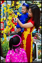 Woman and children in traditional dress for lunar new year. Ho Chi Minh City, Vietnam ( color)