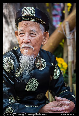 Elder in traditional costume. Ho Chi Minh City, Vietnam (color)