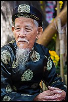 Elder in traditional costume. Ho Chi Minh City, Vietnam ( color)