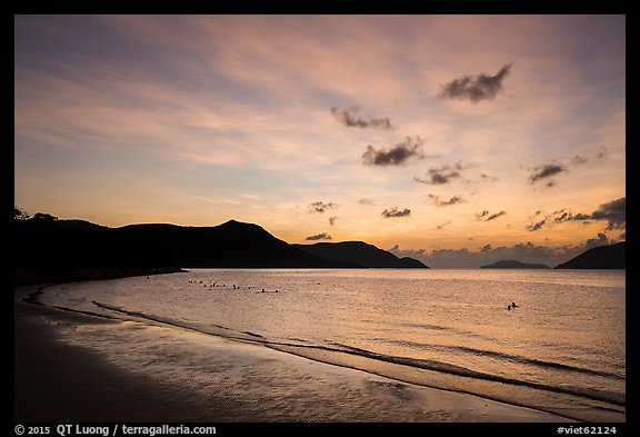 Con Son Beach with people in water before sunrise. Con Dao Islands, Vietnam (color)