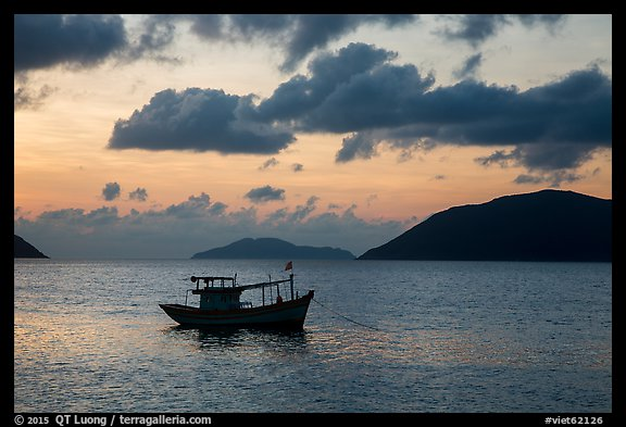 Fishing boat and Con Son Bay, sunrise. Con Dao Islands, Vietnam (color)