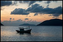 Fishing boat and Con Son Bay, sunrise. Con Dao Islands, Vietnam ( color)
