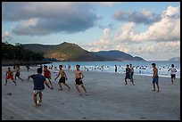 Men play soccer on beach, Con Son. Con Dao Islands, Vietnam ( color)