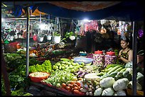 Vegetable seller at night, Con Dao Market, Con Son. Con Dao Islands, Vietnam ( color)