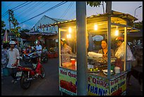 Food vendor at dusk, Con Dao Market, Con Son. Con Dao Islands, Vietnam ( color)