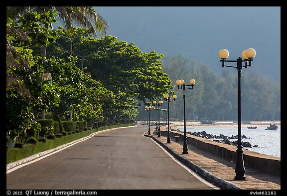 Deserted seafront promenade lined up with lamps, Con Son. Con Dao Islands, Vietnam (color)