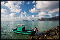 Fisherman climbing on boat, Con Son. Con Dao Islands, Vietnam ( color)