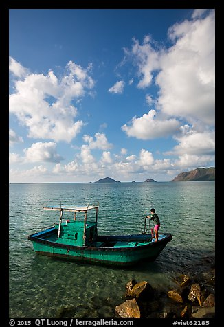 Fisherman lifting anchor from boat, Con Son. Con Dao Islands, Vietnam (color)