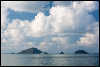 Tropical clouds above Bay Canh Island and other islets. Con Dao Islands, Vietnam ( color)